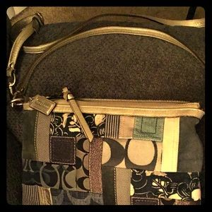 Multi shades of blue and beige Coach purse.